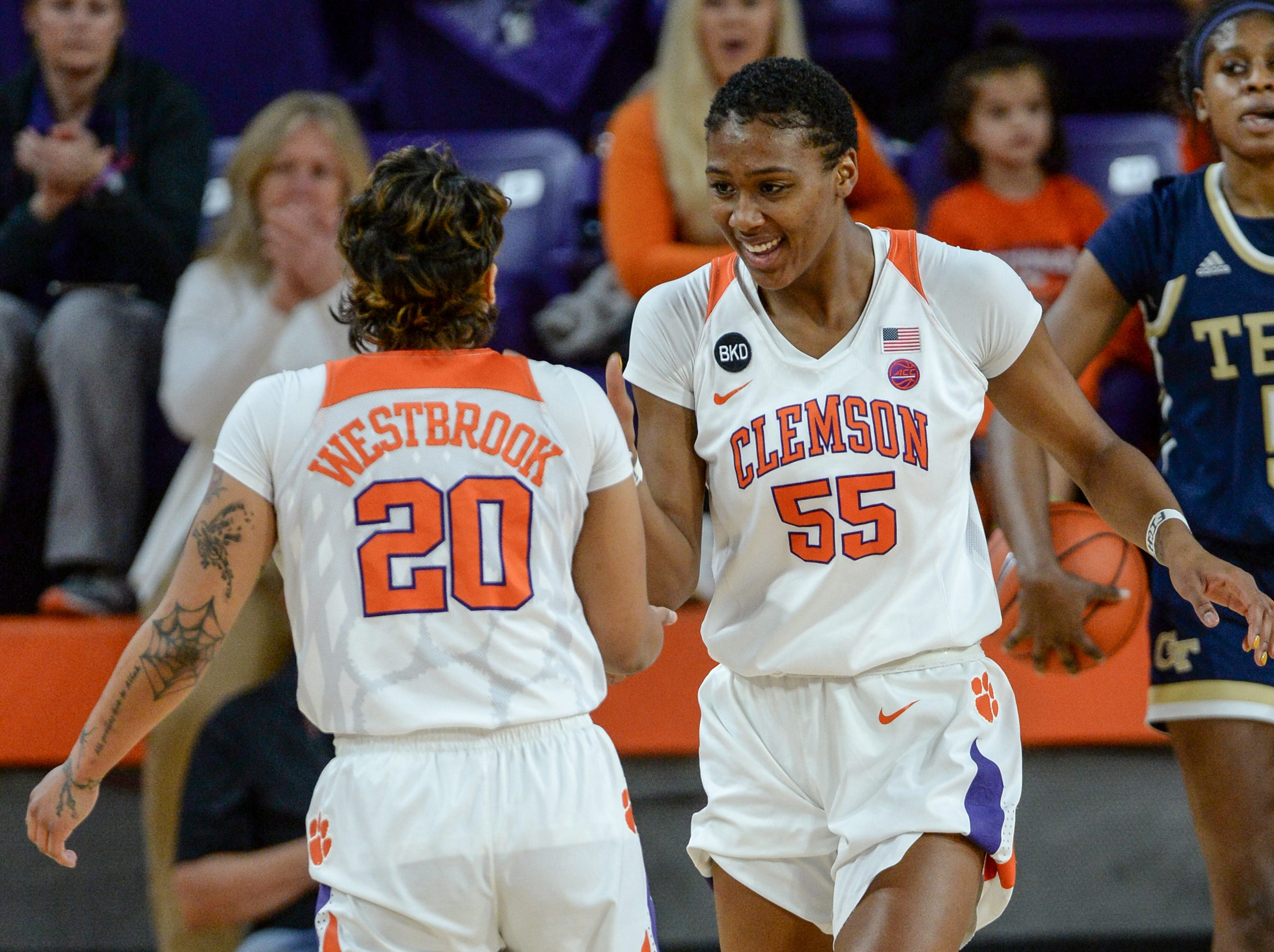 Clemson guard Simone Westbrook(20) is congratulated nay teammate Tylar Bennett(55) for a defensive stop during the second quarter at Littlejohn Coliseum in Clemson Thursday, January 17, 2019.