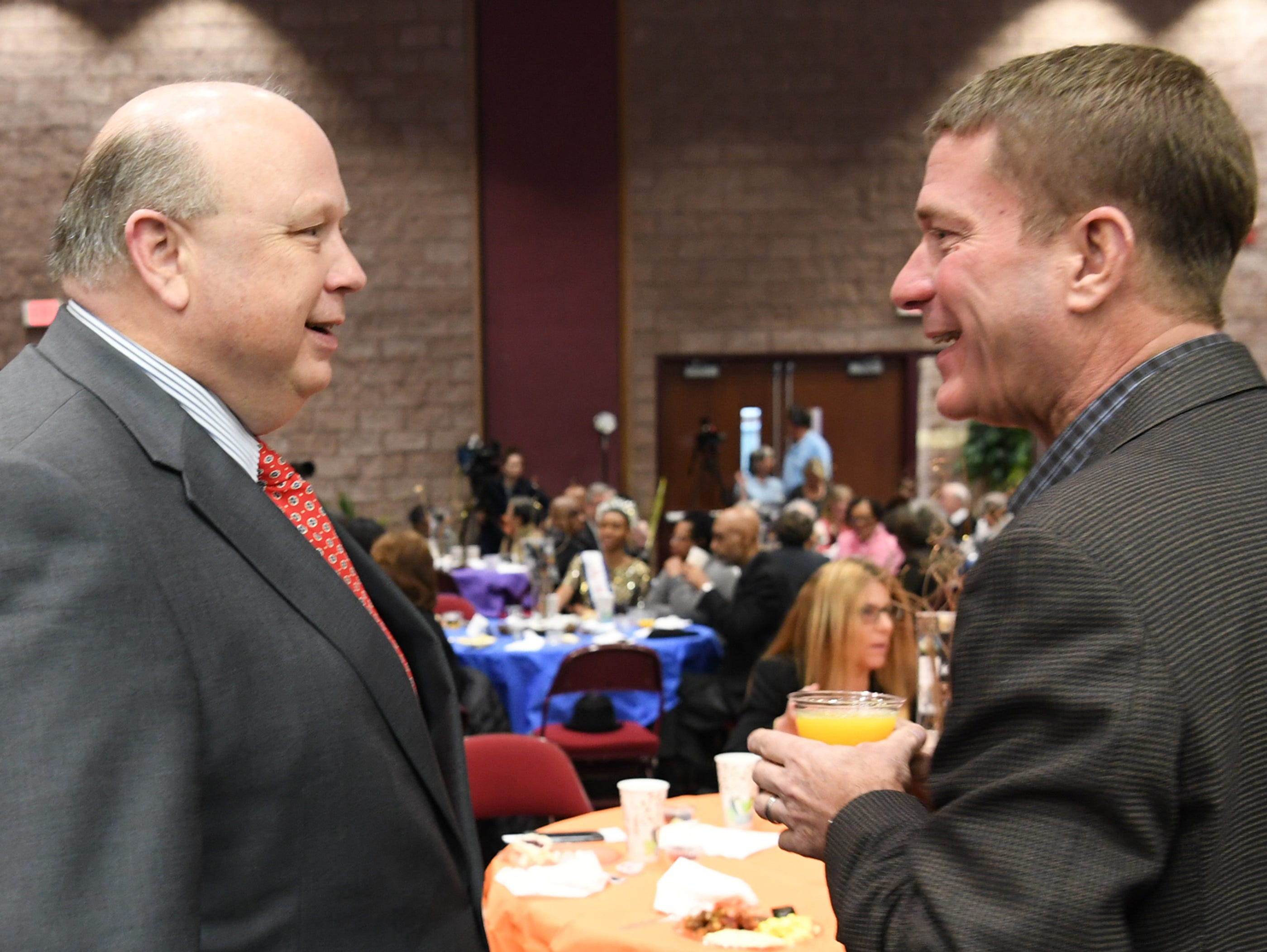 Evans Whitaker, left, Anderson University president and Jeff Roberts, right, city councilman, moments before the beginning of the Mayor's Martin Luther King Jr Breakfast in the Anderson Civic Center Friday, January 18, 2019.