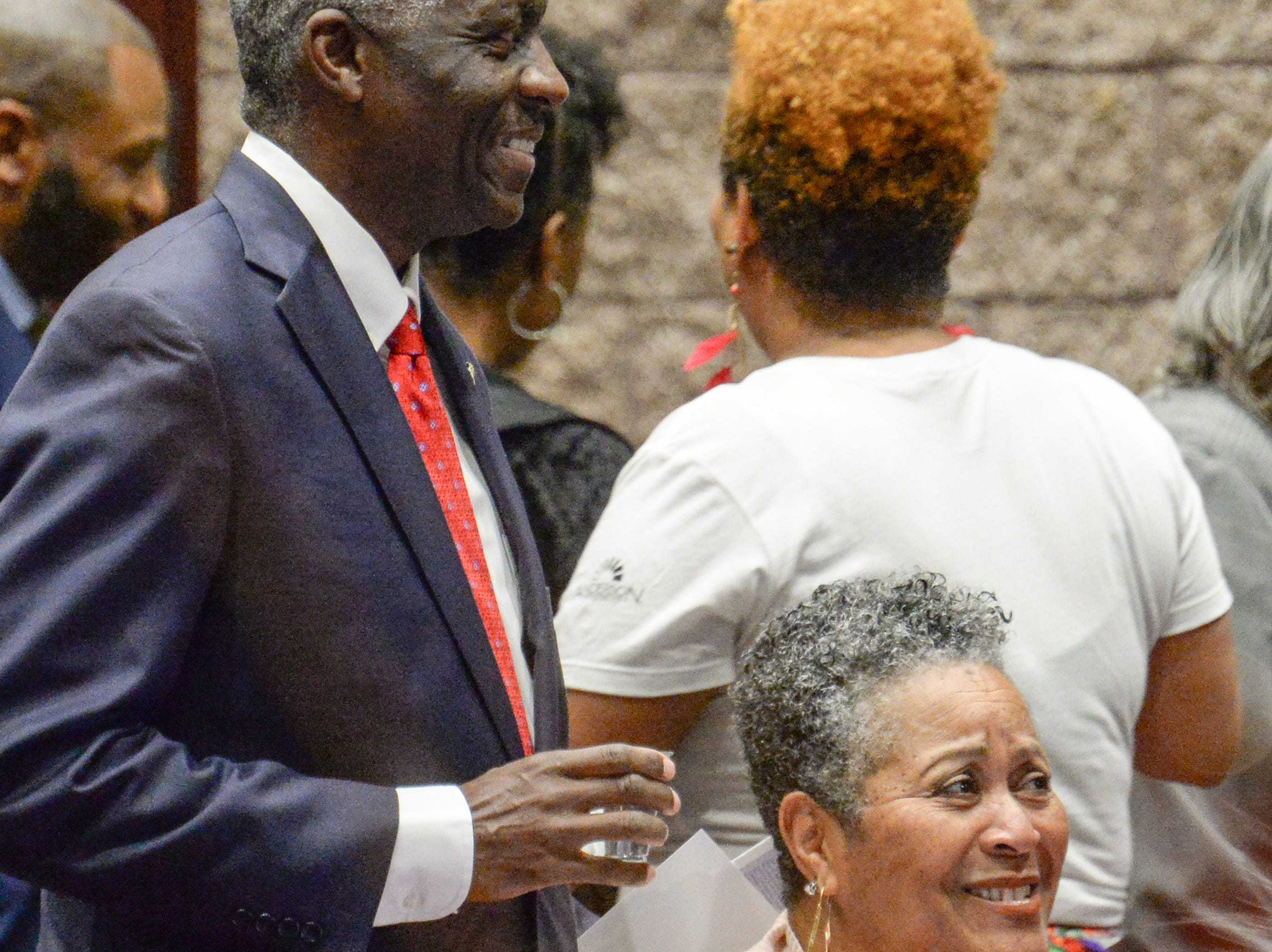 Mayor Terence Roberts, left, and Sandra Gantt of Pendleton town council, greet each other before at the Mayor's Martin Luther King Jr Breakfast in the Anderson Civic Center Friday, January 18, 2019.