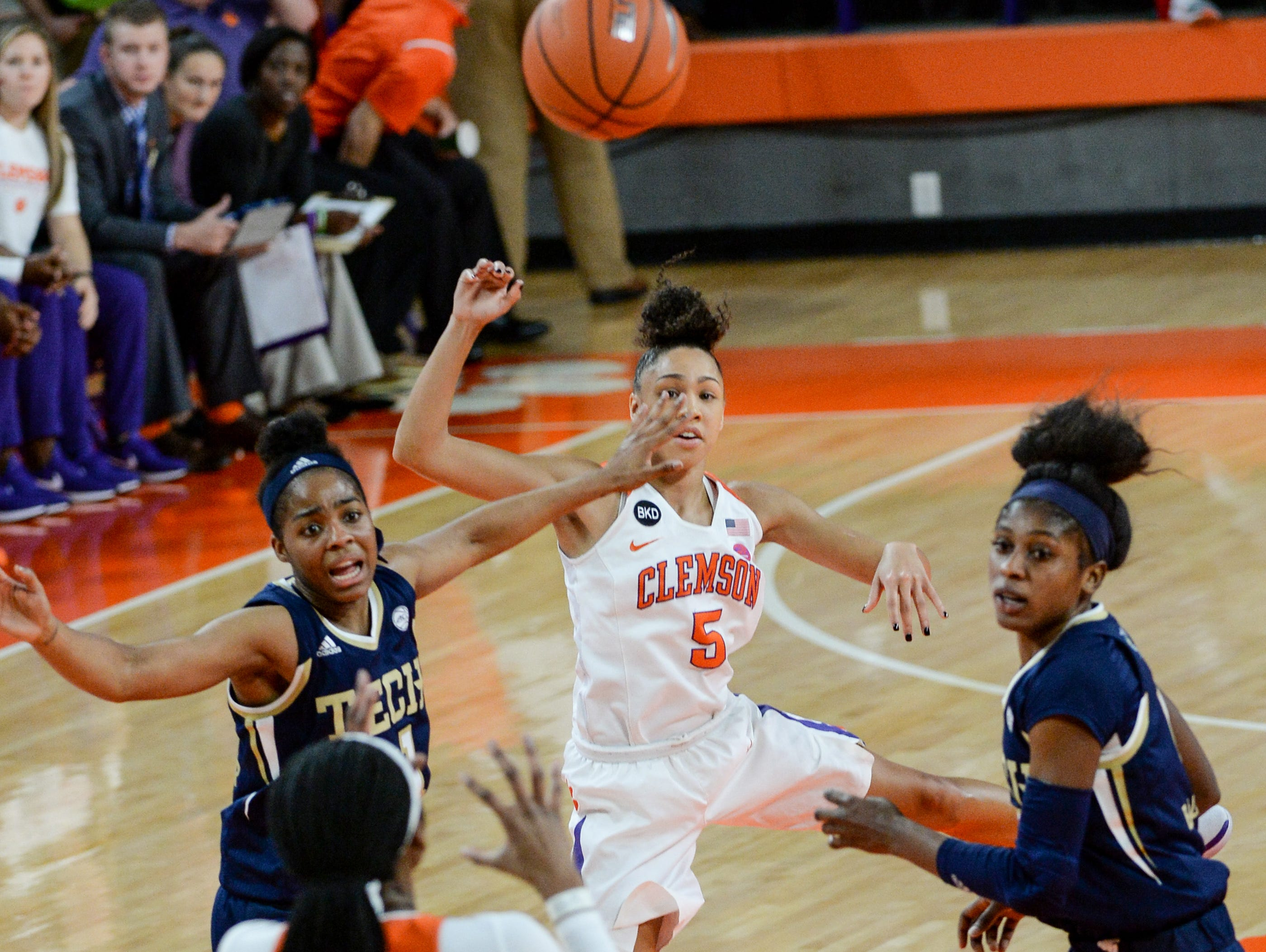 Clemson guard Danielle Edwards(5) passes to Clemson center Kobi Thornton(44) playing Georgia Tech during the first quarter at Littlejohn Coliseum in Clemson Thursday, January 17, 2019.