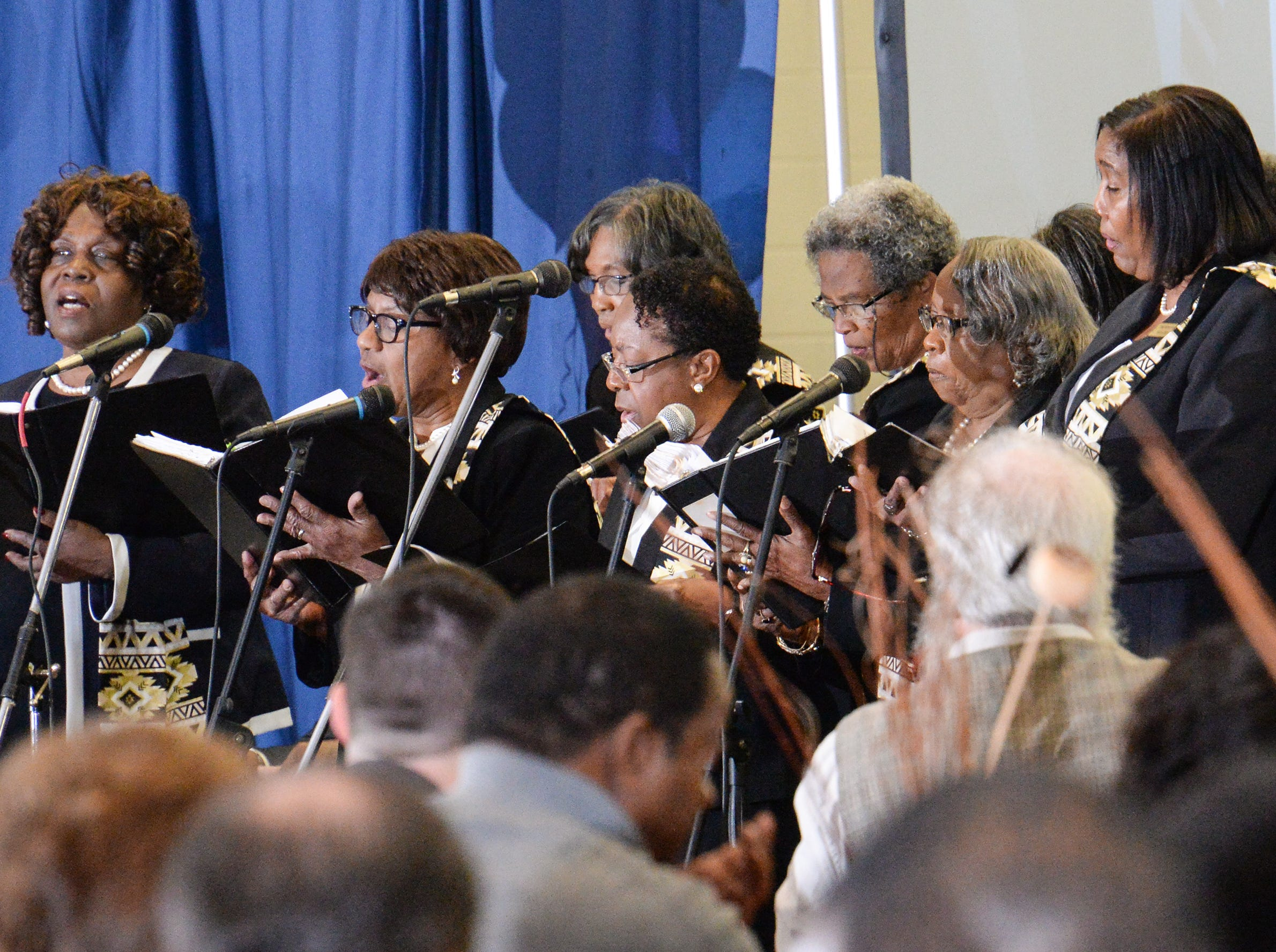 Who, The Community Workshop Choir, sing during the Mayor's Martin Luther King Jr Breakfast in the Anderson Civic Center Friday, January 18, 2019.