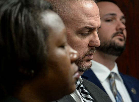 Demika Patterson, Sgt. Kevin Matheson, and Sgt. J.T. Foster listen to Capt. Bill Vaughn speak during a mental health screening initiative press conference at the Anderson County Sheriff's Office Friday, January 18, 2019.