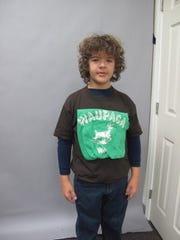 "Gaten Matarazzo models the design of a Waupaca T-shirt during the making of Season 1 of ""Stranger Things"" likely in late 2015."