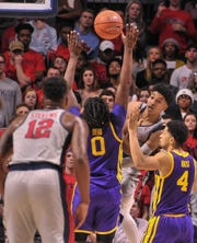 Mississippi Rebels guard Breein Tyree (4) passes the ball to Mississippi Rebels forward Bruce Stevens (12) against LSU Tigers forward Naz Reid (0)