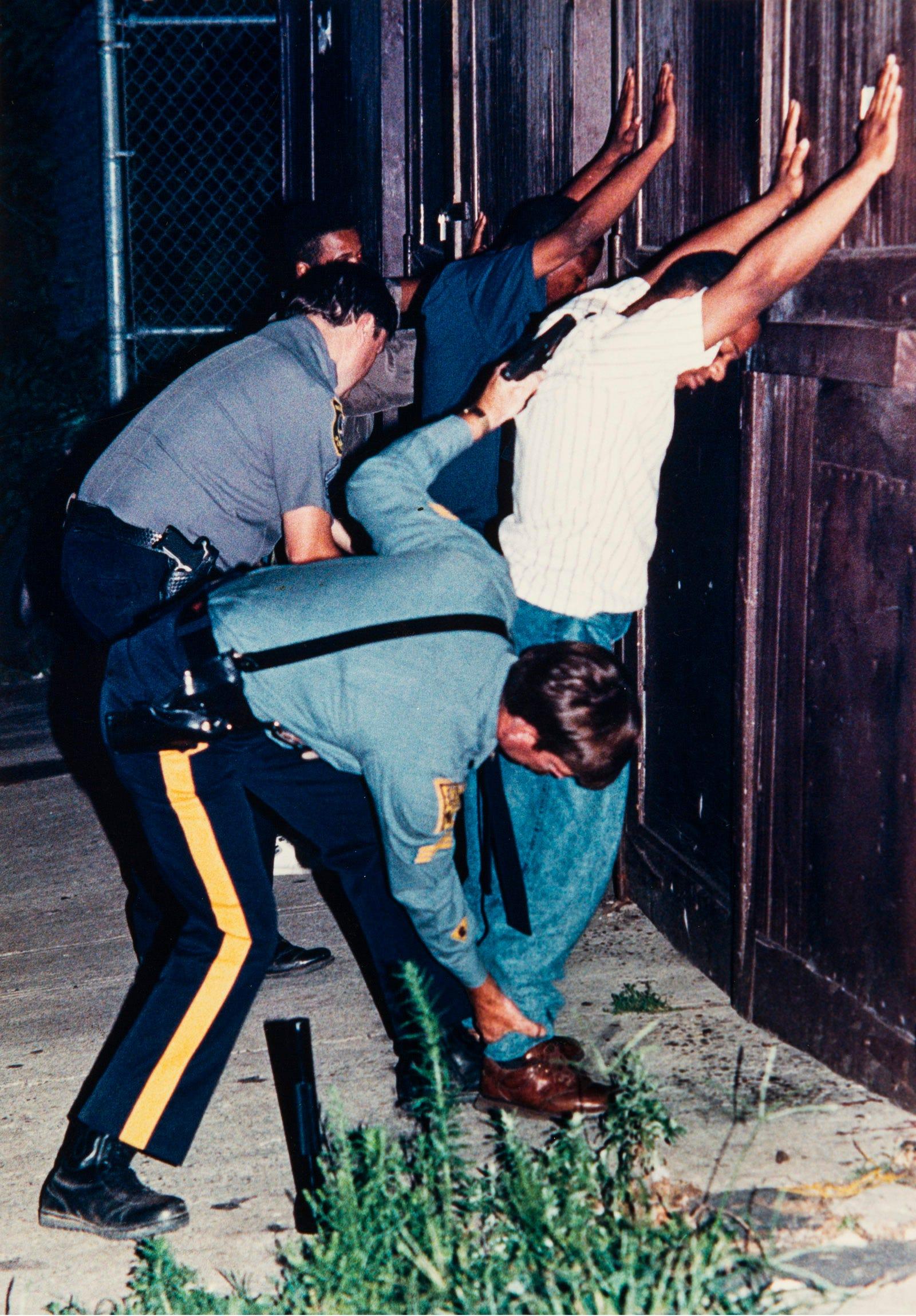 Suspects being taken into custody in Newark in 1990.