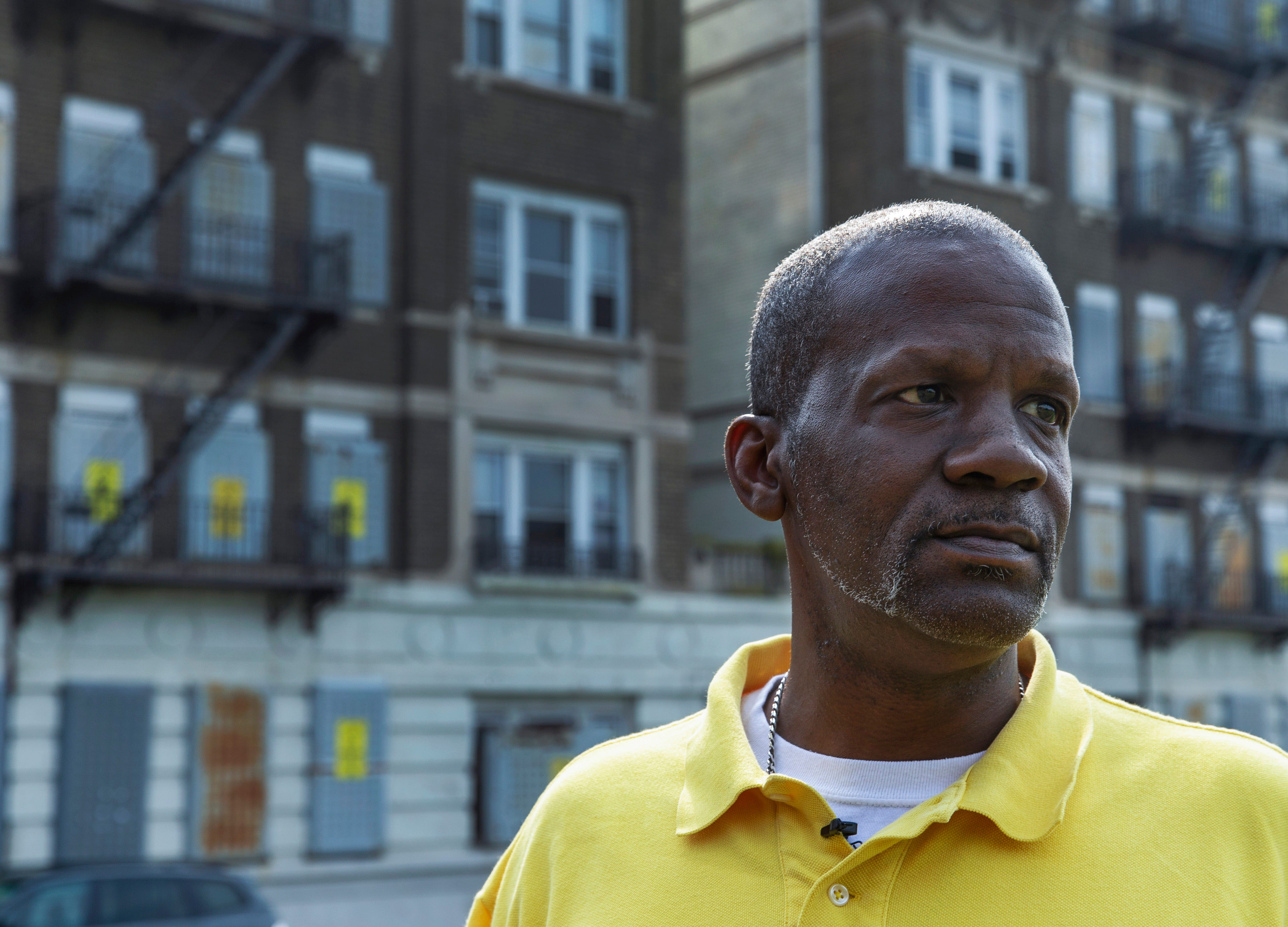 Dannis Billups shown outside the Aspen Stratford Apartments, the building in Newark, New Jersey where he started dealing drugs as a teenager in the 1980s.