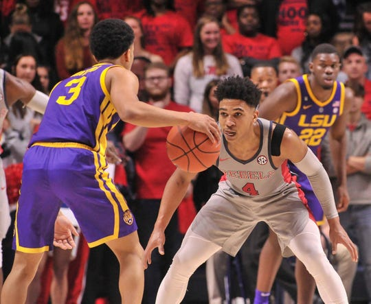 Mississippi Rebels guard Breein Tyree (4) guards LSU Tigers guard Tremont Waters (3)