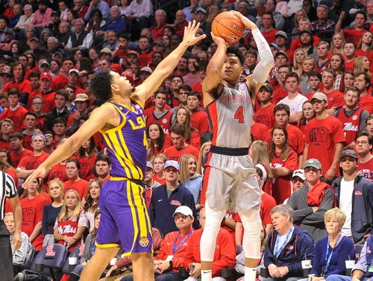 Mississippi Rebels guard Breein Tyree (4) shoots against LSU Tigers guard Skylar Mays (4)