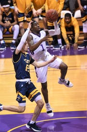 Hardin-Simmons guard Chris Barrett (1) goes up for a layup at the Mabee Complex against Howard Payne on Thursday, Jan. 17, 2019.