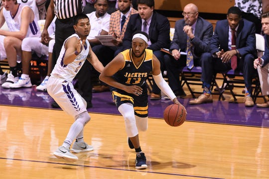 Howard Payne's Javaris Jones (13) dribbles while defended by Hardin-Simmons' Joe Hoeup (2) at the Mabee Complex on Thursday, Jan. 17, 2019.