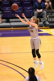 Hardin-Simmons forward Karlea Ritchie (14) takes a 3-pointer against Howard Payne at the Mabee Complex on Thursday.
