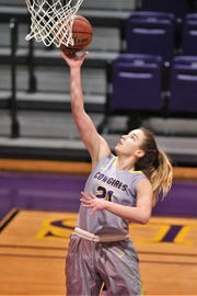Hardin-Simmons center Kaitlyn Ellis (21) lays the ball in against Howard Payne at the Mabee Complex on Thursday, Jan. 17, 2019.