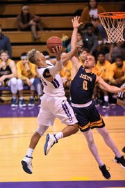 HSU's Jalen Terry (23) fights off a Howard Payne defender for a shot at the Mabee Complex on Thursday, Jan. 17, 2019.