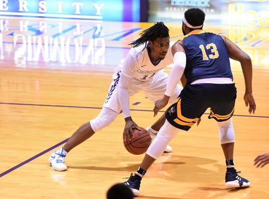HSU freshman guard Steven Quinn (14) makes a move against a Howard Payne defender during last week's game. Quinn finished with 29 points in the win, which followed a 30-point performance at the beginning of the month.