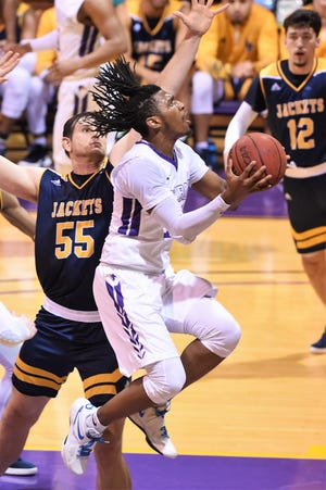 Hardin-Simmons' Steven Quinn (14) scores two of his game-high 29 points against Howard Payne last Thursday. Quinn is already proving himself a scoring option as a freshman for the Cowboys.
