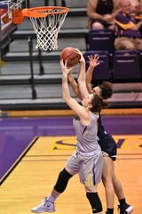 HSU forward Keilee Burke (11) pulls down a rebound early in the season. Burke has been a rebounding machine for the Cowgirls, but has lately gotten her offense going too.