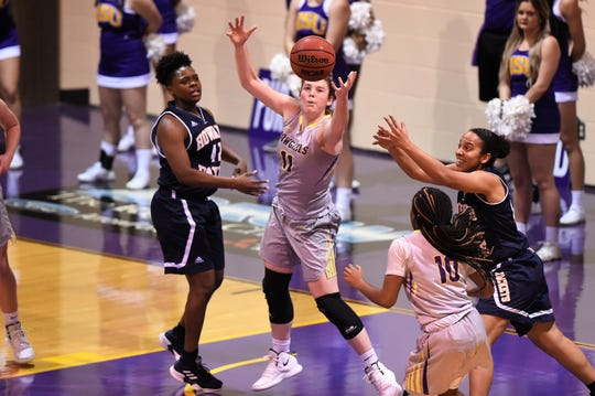 HSU forward Keilee Burke (11) looks in a defensive rebound early in the season against Howard Payne. Burke has pulled down double-digit rebounds eight times this season and averages 10.2 boards per game.