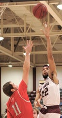 McMurry's Mike Williams Jr. (22) shoots over Sul Ross State's B.J. Hollis during the first half. McMurry won the American Southwest Conference game 80-79 on Thursday, Jan. 17, 2019, at Kimbrell Arena.