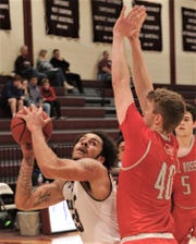 McMurry's Jordan Jackson, left, eyes the basket while Sul Ross State's Jack Kirkpatrick defends. McMurry won the American Southwest Conference game 80-79 on Thursday, Jan. 17, 2019, at Kimbrell Arena.