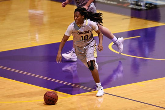 Taylor Gaffney (10) pushes the ball for Hardin-Simmons against Howard Payne at the Mabee Complex on Thursday, Jan. 17, 2019.