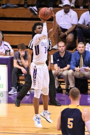 There is no shot too big for HSU's Steven Quinn (14) who has scored 29 and 30 points in two of the last five games. Quinn is second on the team with 11.8 points per game and is scoring 13.5 points per ASC contest.