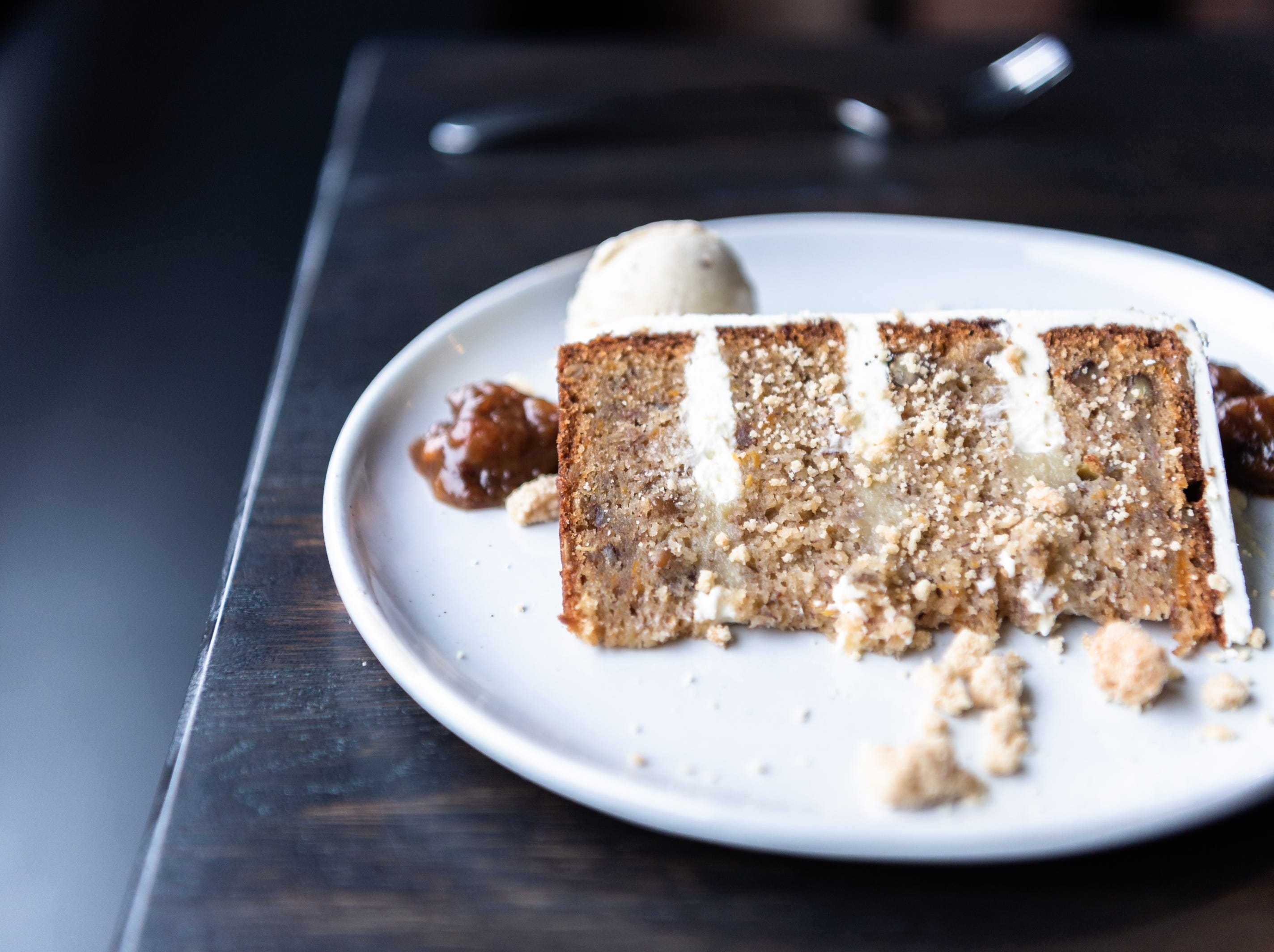 Hummingbird cake served with a scoop of sunflower ice cream offered at Benne on Eagle at the Foundry Hotel.