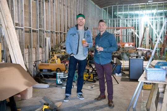 Wicked Week co-founder Walt Dickinson, left, and chef and Table founder Jacob Sessoms stand in the construction area that will soon become Cultura, a new restaurant soon to be added to the Wicked Weed's Funkatorium on the South Slope.