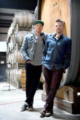 Wicked Week co-founder Walt Dickinson, left, and chef and Table founder Jacob Sessoms pose with a foeder, or large aging barrel, that will soon become a booth in their new restaurant, Cultura, soon be added to the Wicked Weed's Funkatorium on the South Slope.