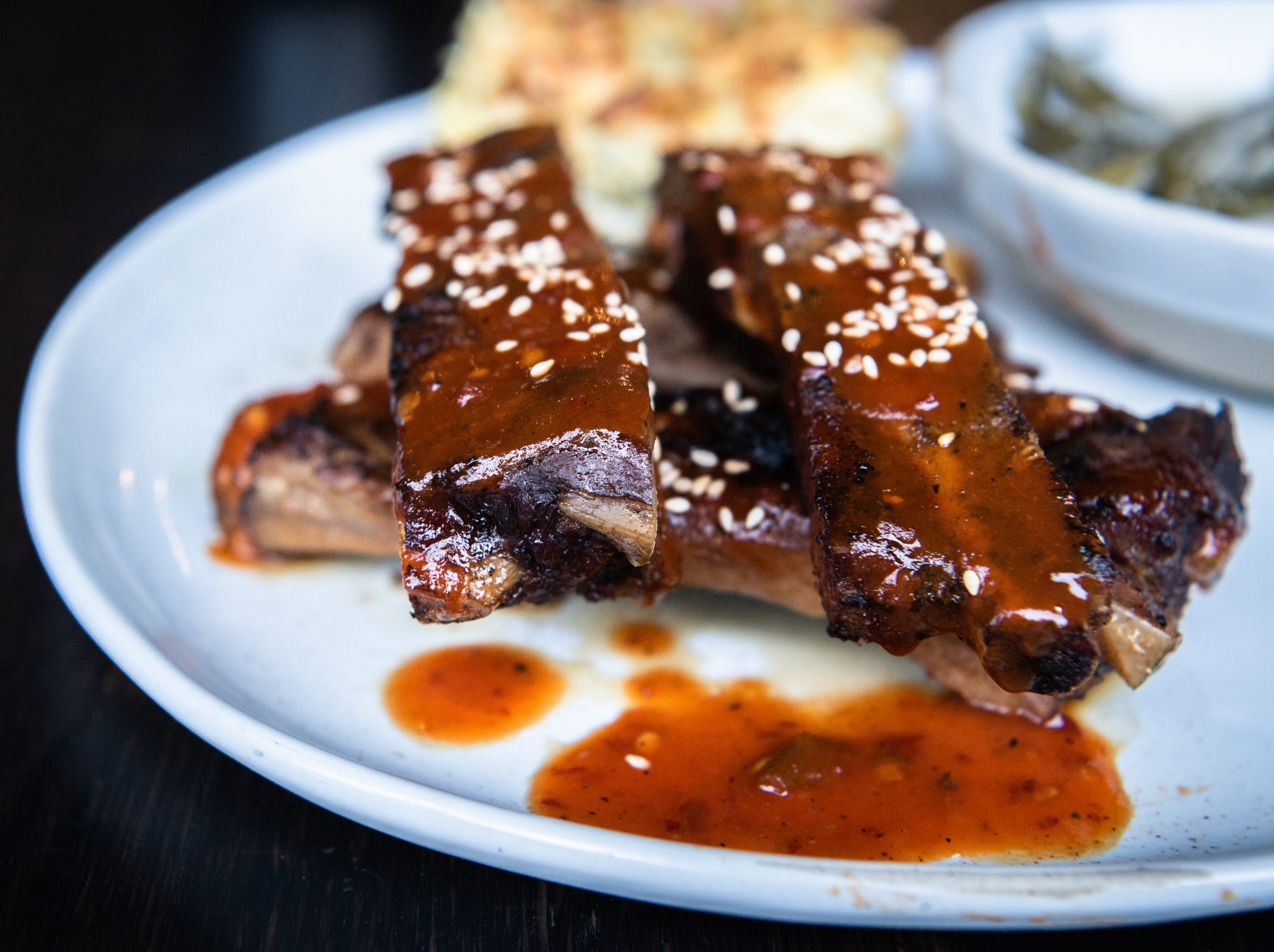 Barbecued pork ribs served with spoon bread and buttermilk britches offered at Benne on Eagle at the Foundry Hotel.