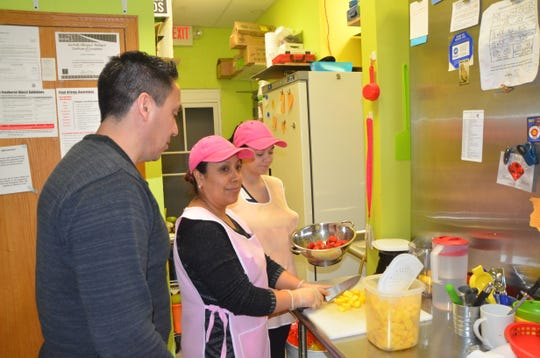 Mango Healthy Fruit and Food owner Alberto Guerrero interacts with employees at the restaurant's Columbia Avenue location on Jan. 18, 2019.