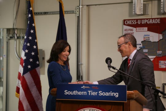 Joel Malina, Cornell vice president of university relations, shakes the hand of Lieutenant Governor Kathy Hochul.