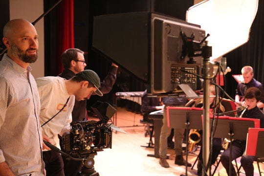 Producer and director Kirk Sullivan, left, oversees the filming of the PSA.