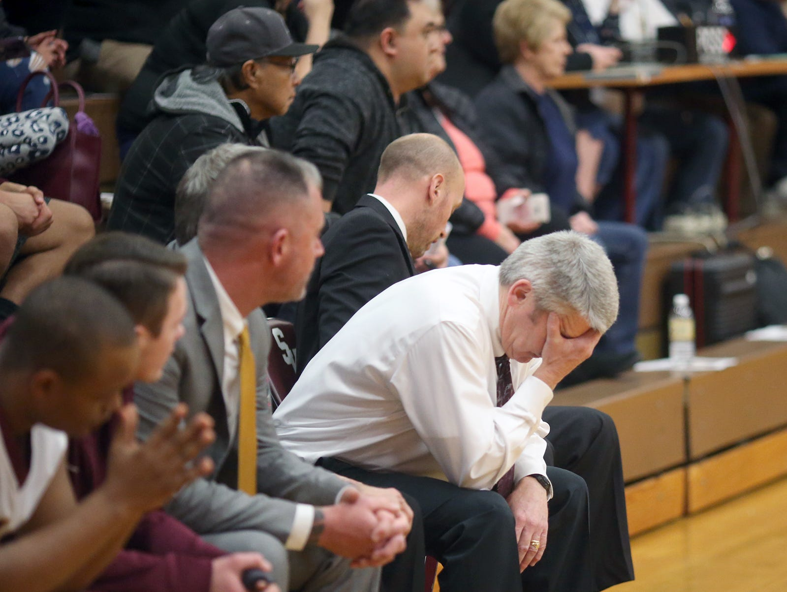 South Kitsap High School varsity head basketball coach John Callaghan won his 300th game against Bellarmine at South Kitsap on Thursday, January 17, 2019. Callaghan gives a kiss to his wife Denise at mid-court after the game. Coach Callaghan reacts to a late game turnover.