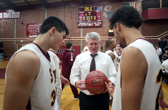 South Kitsap boys basketball coach John Callaghan earned his 300th career victory Thursday night as his Wolves beat Bellarmine Prep 36-30. Callaghan was awarded a game ball commemorating the win.