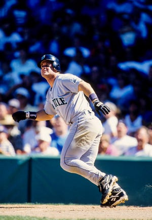 Edgar Martinez watches the flight of a ball during a 1997 game at Fenway Park in Boston. Martinez, a legendary hitter who spent his entire career with Seattle, enters the baseball Hall of Fame Sunday.