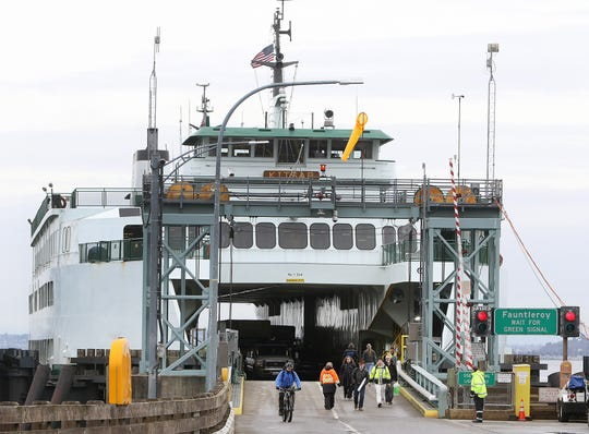 Passengers disembark the ferry Kitsap at Southworth on Friday. Washington State Ferries ridership grew in 2018 to nearly 25 million total, the system's highest number since 2002.
