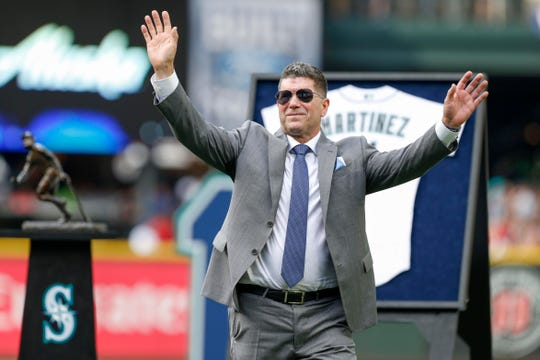 Edgar Martinez acknowledges fans following his jersey retirement ceremony in 2017.