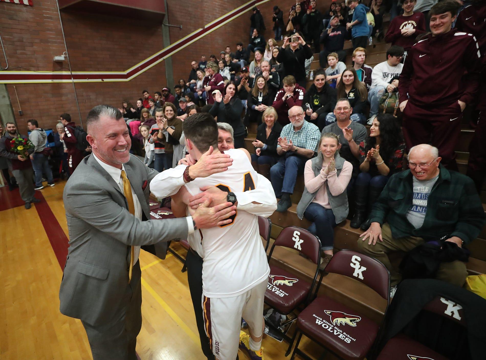 South Kitsap High School varsity head basketball coach John Callaghan won his 300th game against Bellarmine at South Kitsap on Thursday, January 17, 2019.  Coach Callaghan gets hugs after the game.