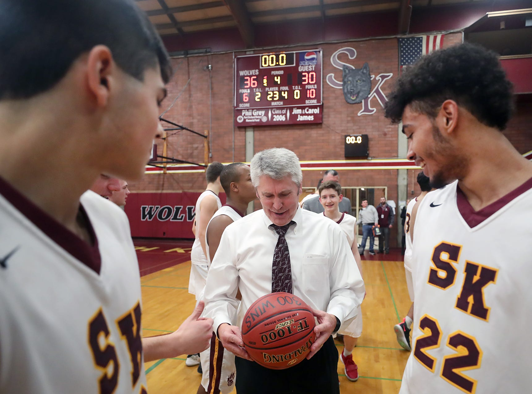 South Kitsap High School varsity head basketball coach John Callaghan won his 300th game against Bellarmine at South Kitsap on Thursday, January 17, 2019. An emotional Callaghan was given a  ball with his 300th victory on it.