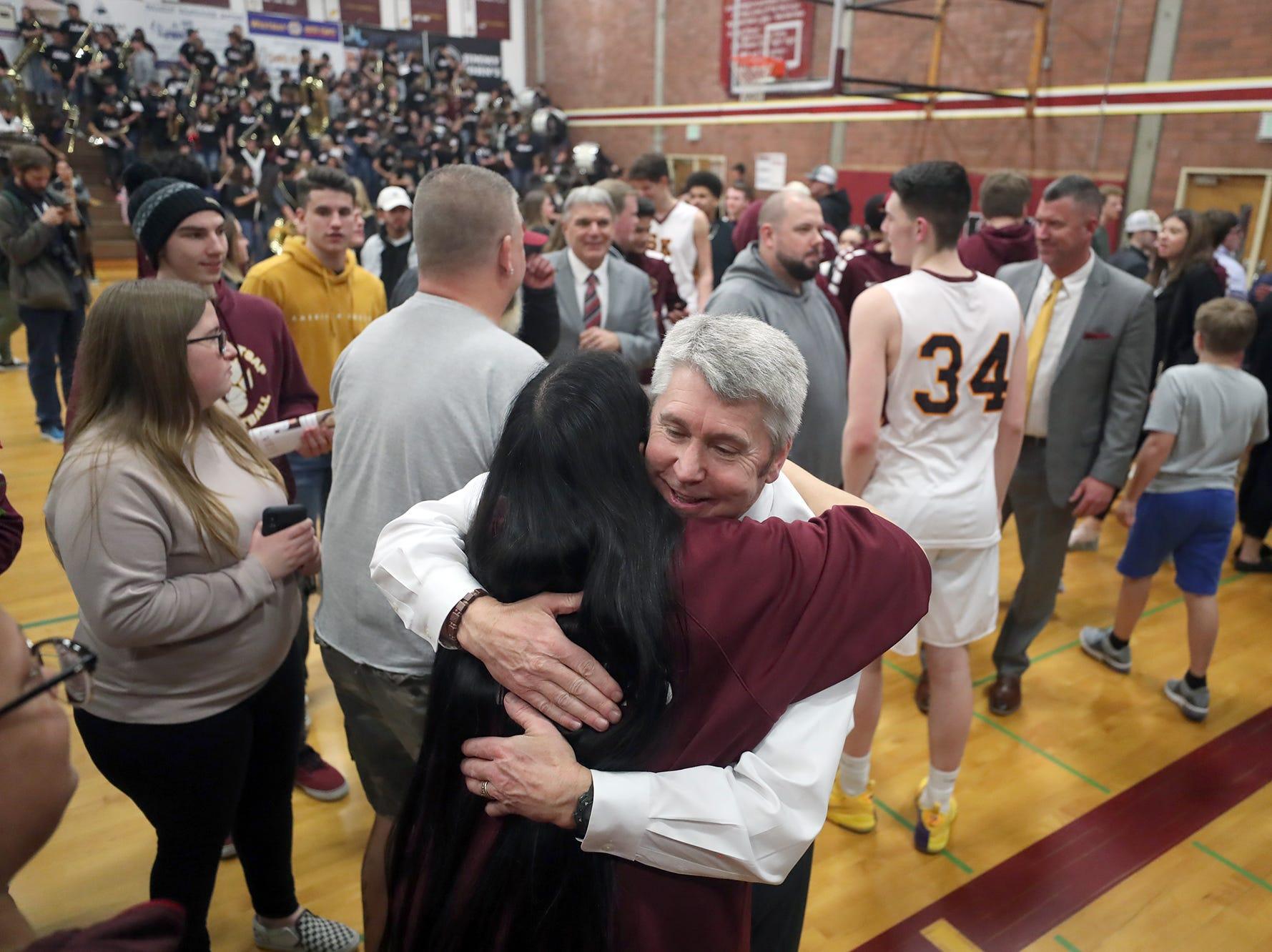 South Kitsap High School varsity head basketball coach John Callaghan won his 300th game against Bellarmine at South Kitsap on Thursday, January 17, 2019. Callaghan gets hugs after the game.