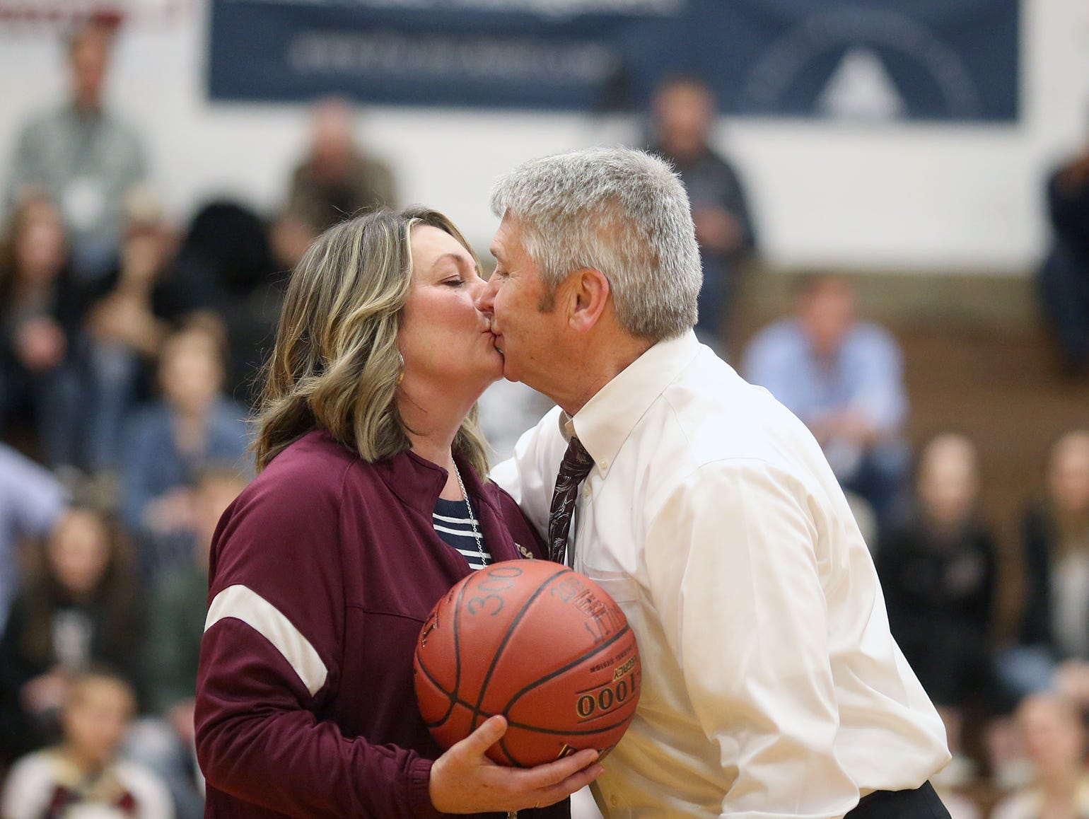 South Kitsap High School varsity head basketball coach John Callaghan won his 300th game against Bellarmine at South Kitsap on Thursday, January 17, 2019. Callaghan gives a kiss to his wife Denise at mid-court after the game.
