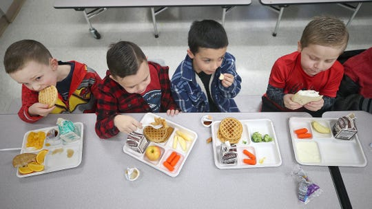 Students at a school in Washington state enjoy lunch on Jan. 18.