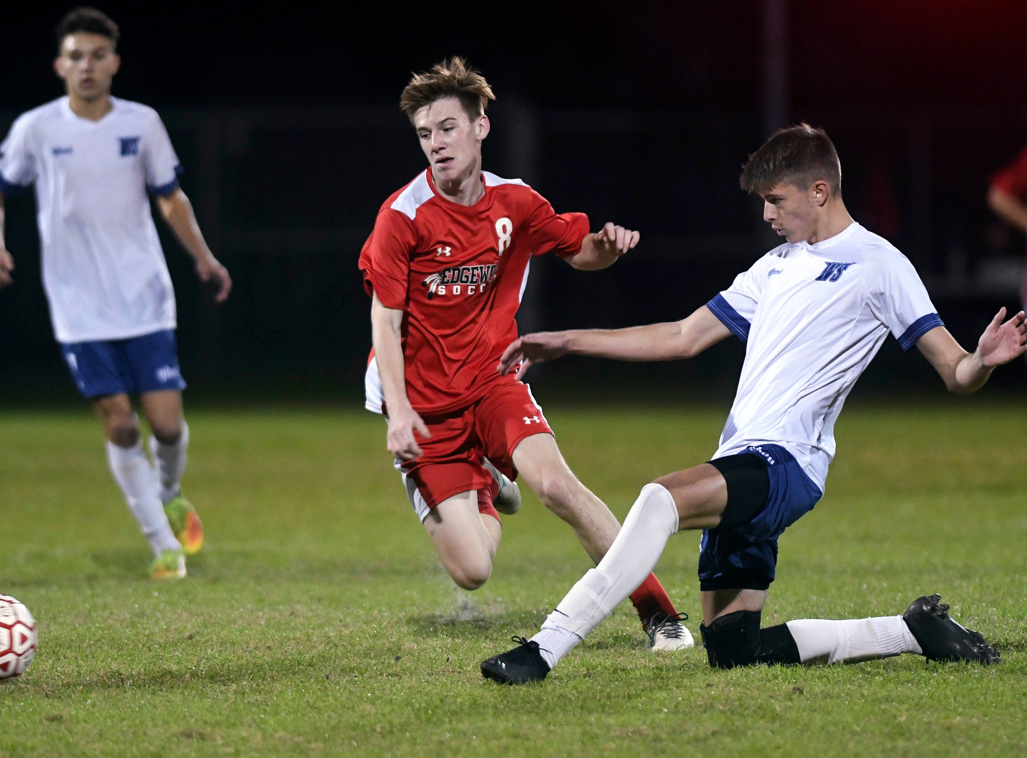 Grant Hester of West Shore directs the ball away from Scott Quigley of Edgewood during Thursday's Cape Coast Conference championship game.