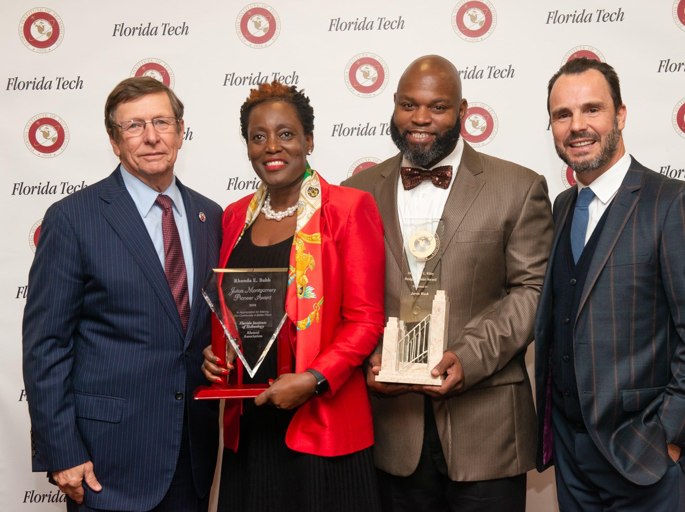 Julius Montgomery Pioneer award winner judge Rhonda E. Babb and Bridge Builder award winner Jarvis Wash.