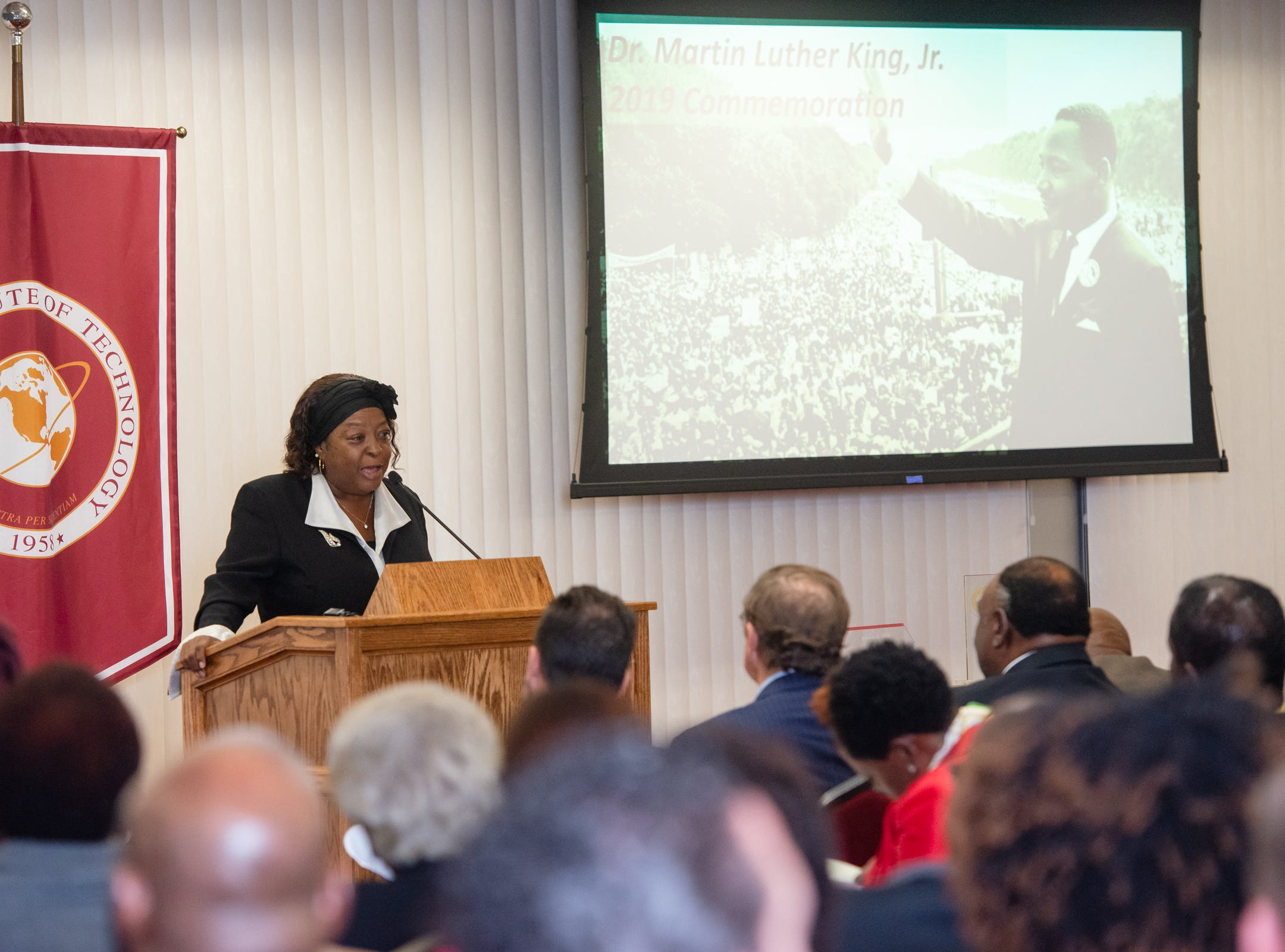 Rev. Carolyn P. Farrior, director of admissions for online learning and off-campus programs at Florida Tech, speaks at the Julius Montgomery Pioneer Award and the Dr. Harvey L. Riley Bridge Builder Award presentation in celebration of Martin Luther King Jr. Day.