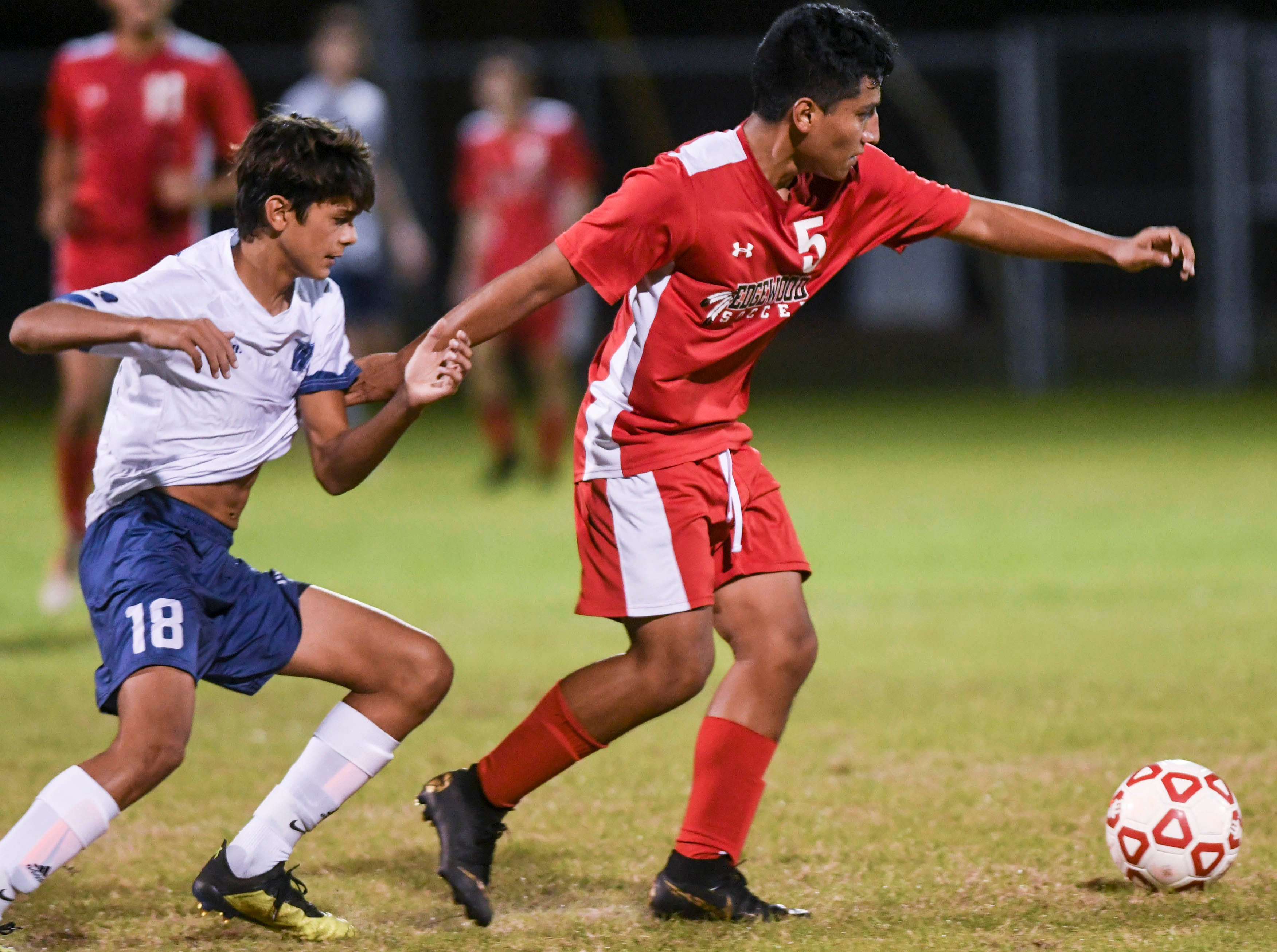Ian Nemes of West Shore pursues Danny Ordonez of Edgewood during Thursday's Cape Coast Conference championship game.
