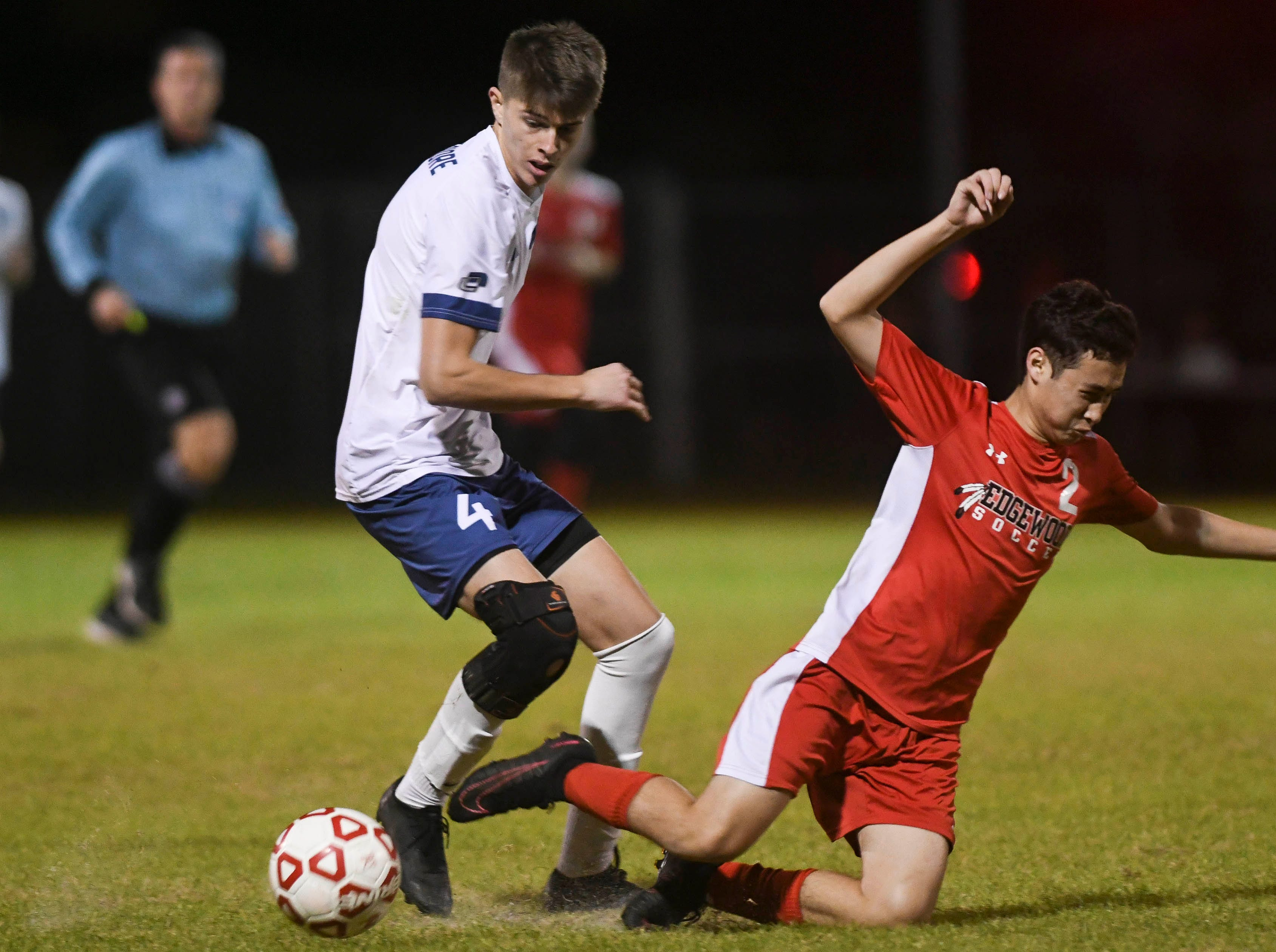 West Shore's Case Hester trips Ethan Decesare of Edgewood during Thursday's Cape Coast Conference championship game.