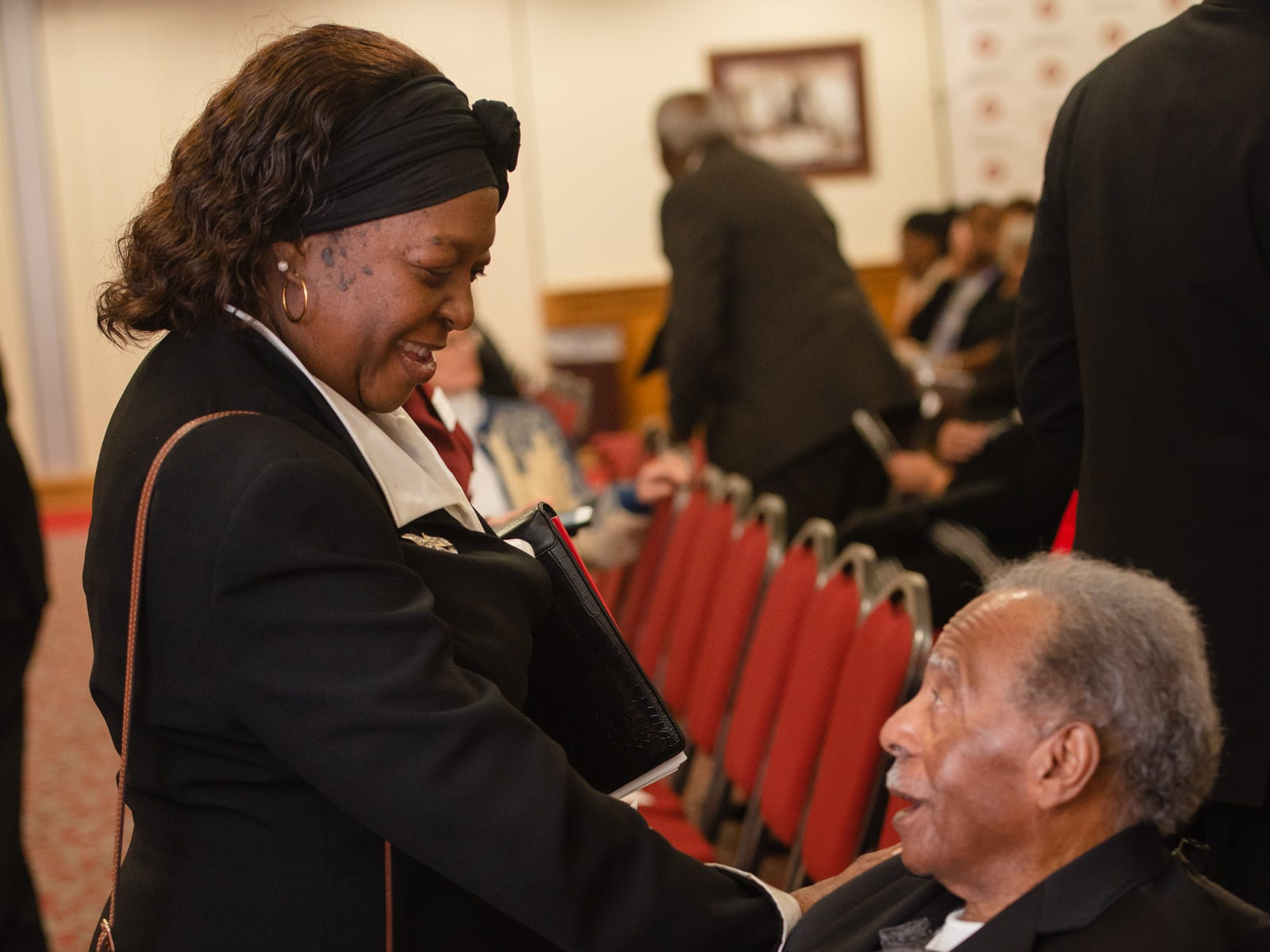 Rev. Carolyn Farrior speaks with Julius Montgomery before the start of the Julius Montgomery Pioneer Award and the Dr. Harvey L. Riley Bridge Builder Award presentation in celebration of Martin Luther King Jr. Day.