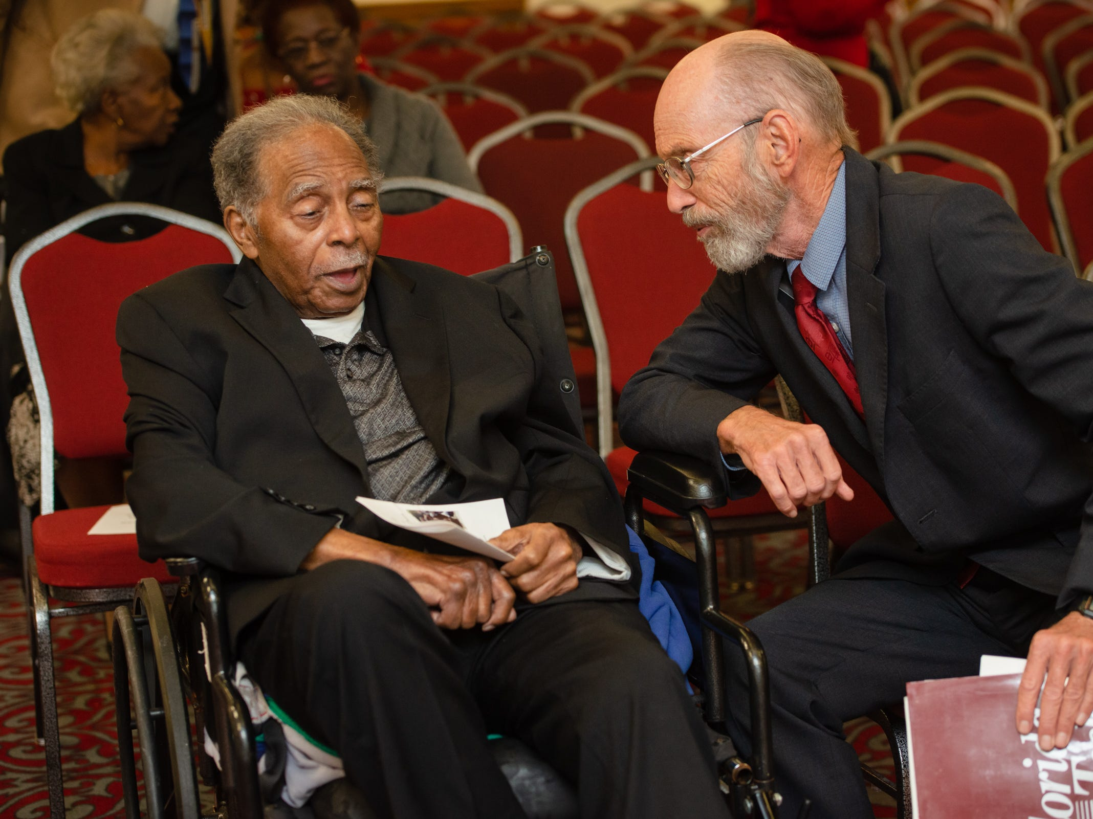 Julius Montgomery and Dr. Gordon Patterson visit together before the start of the Julius Montgomery Pioneer Award and the Dr. Harvey L. Riley Bridge Builder Award presentation in celebration of Martin Luther King Jr. Day.