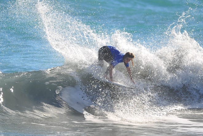 Melbourne Beach native Caroline Marks kicks up some spray during the final day of the Florida pro surf contest at Sebastian Inlet. She won $8,000.